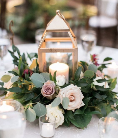 Gold Lantern Centerpiece With Ring Of Flowers And Greenery.PNG