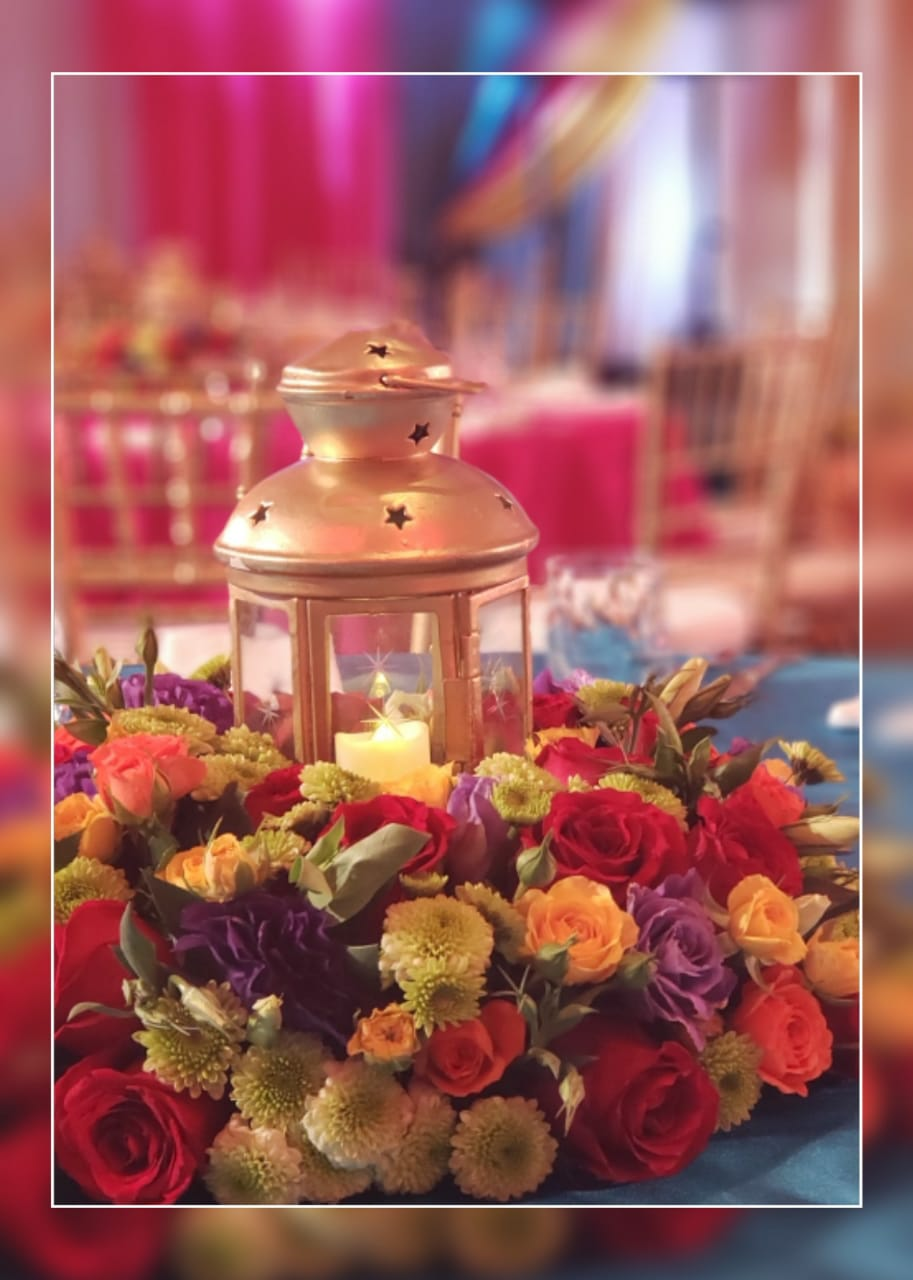 Small Moroccan Lanterns In Gold Color Surrounded By Flowers On Bright Colors
