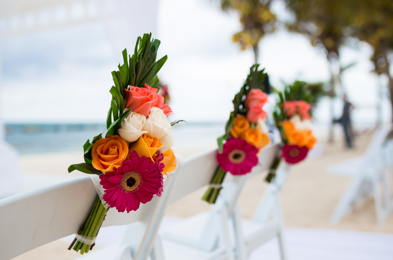 Chair Corsage With Tropical Flowers And Palm Leaves.png