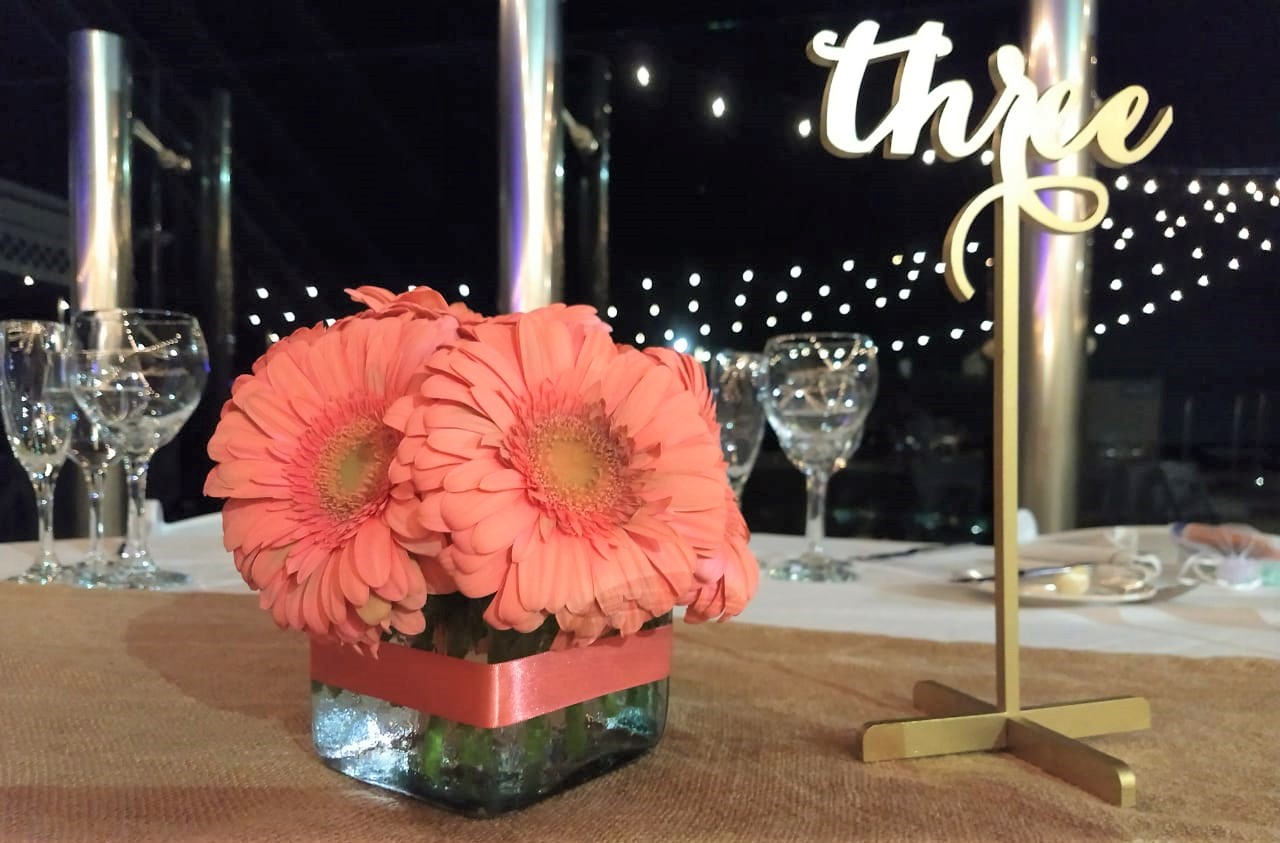 Gold Table Number With Gerber Daisies