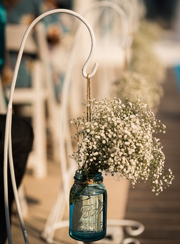Mason Jar With Babys Breath On A Shepherds Hook