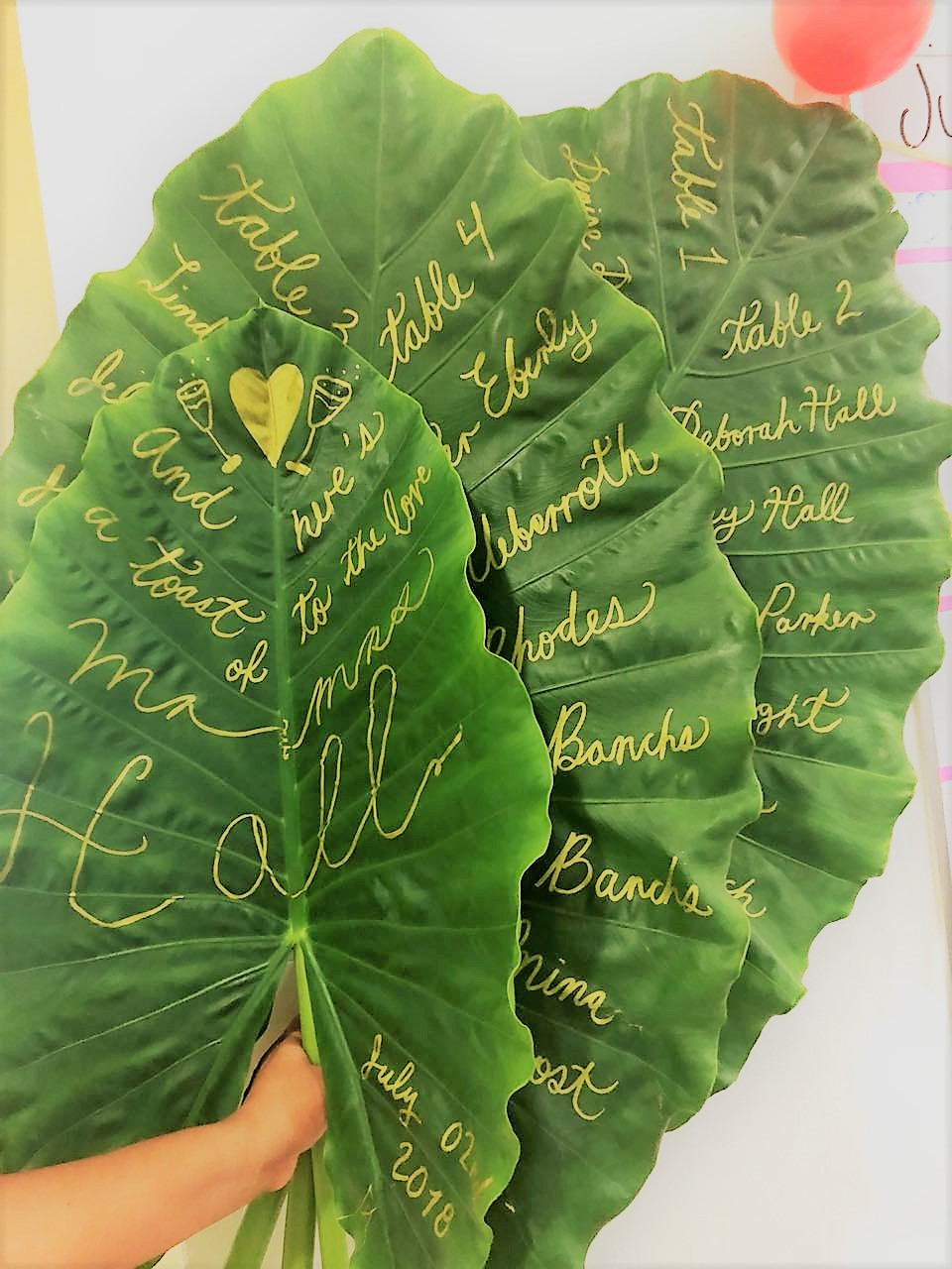 Monstera Leave Seating Chart With Hand Written Names And Table Numbers2