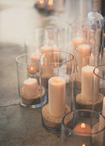 Set Of Five Crystal Cylinders With Sand And Pillar Candles.PNG