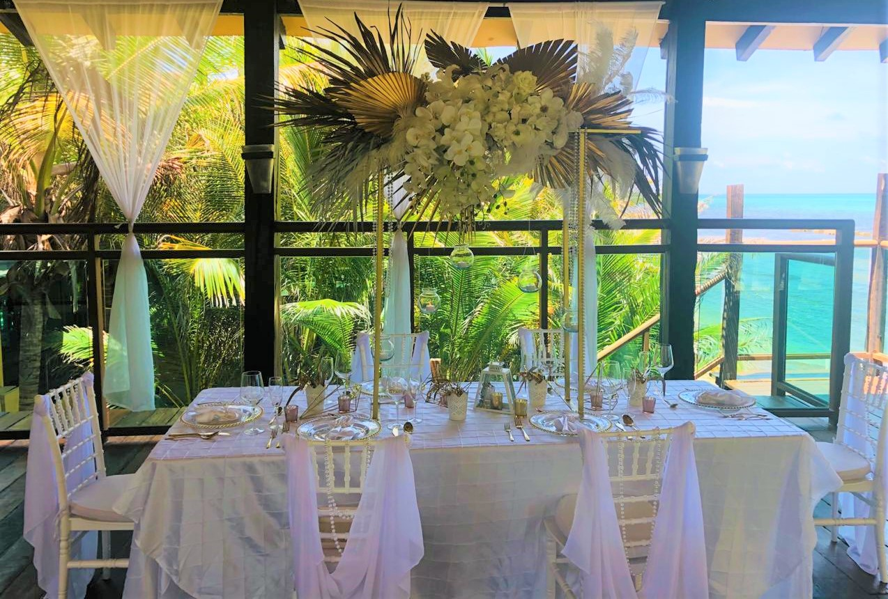 Tall Centerpiece With Feathers And Foliage Gold And White