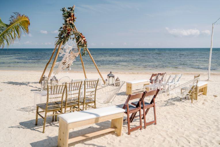 Teepee Benches Brown Chairs Beach.JPG