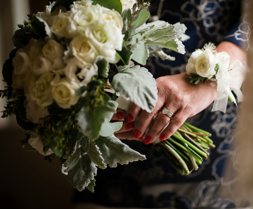 Wrist Corsage With Mini Ranunculus And Roses.PNG