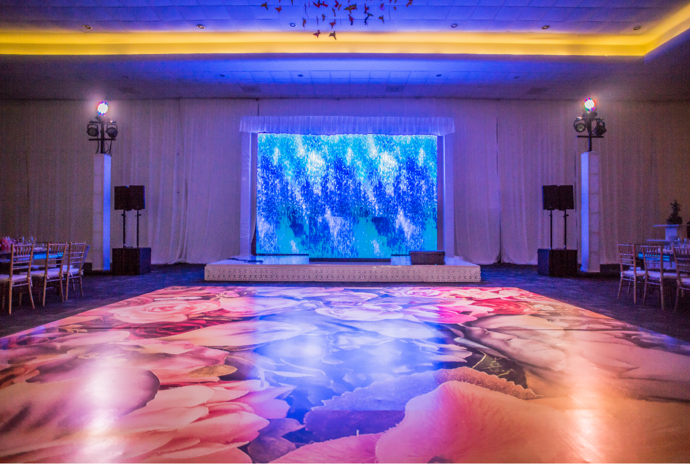 Wooden_dance_floor_covered_with_printed_vinyl.PNG